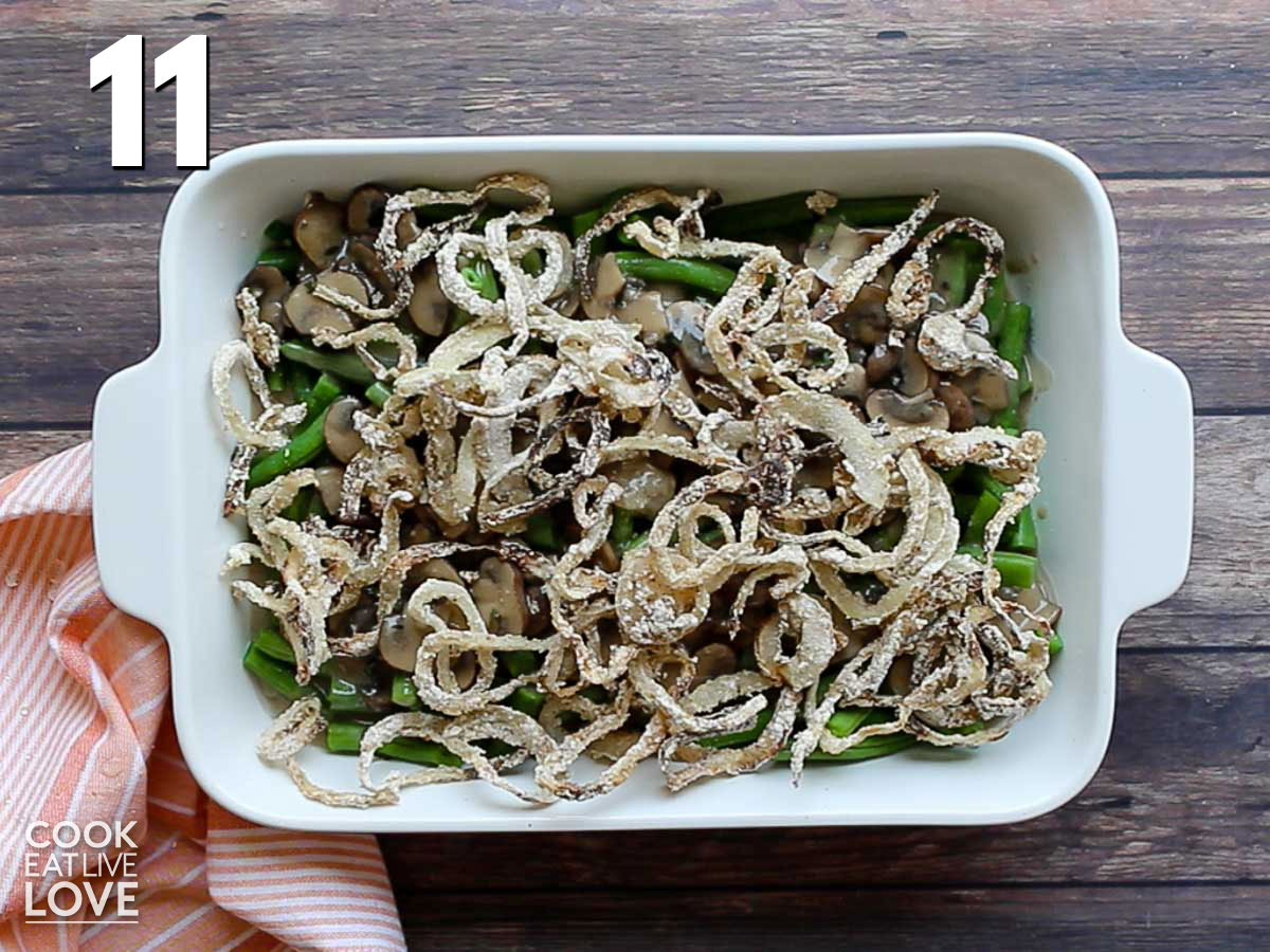 Dairy free green bean casserole in a baking dish ready for the oven.