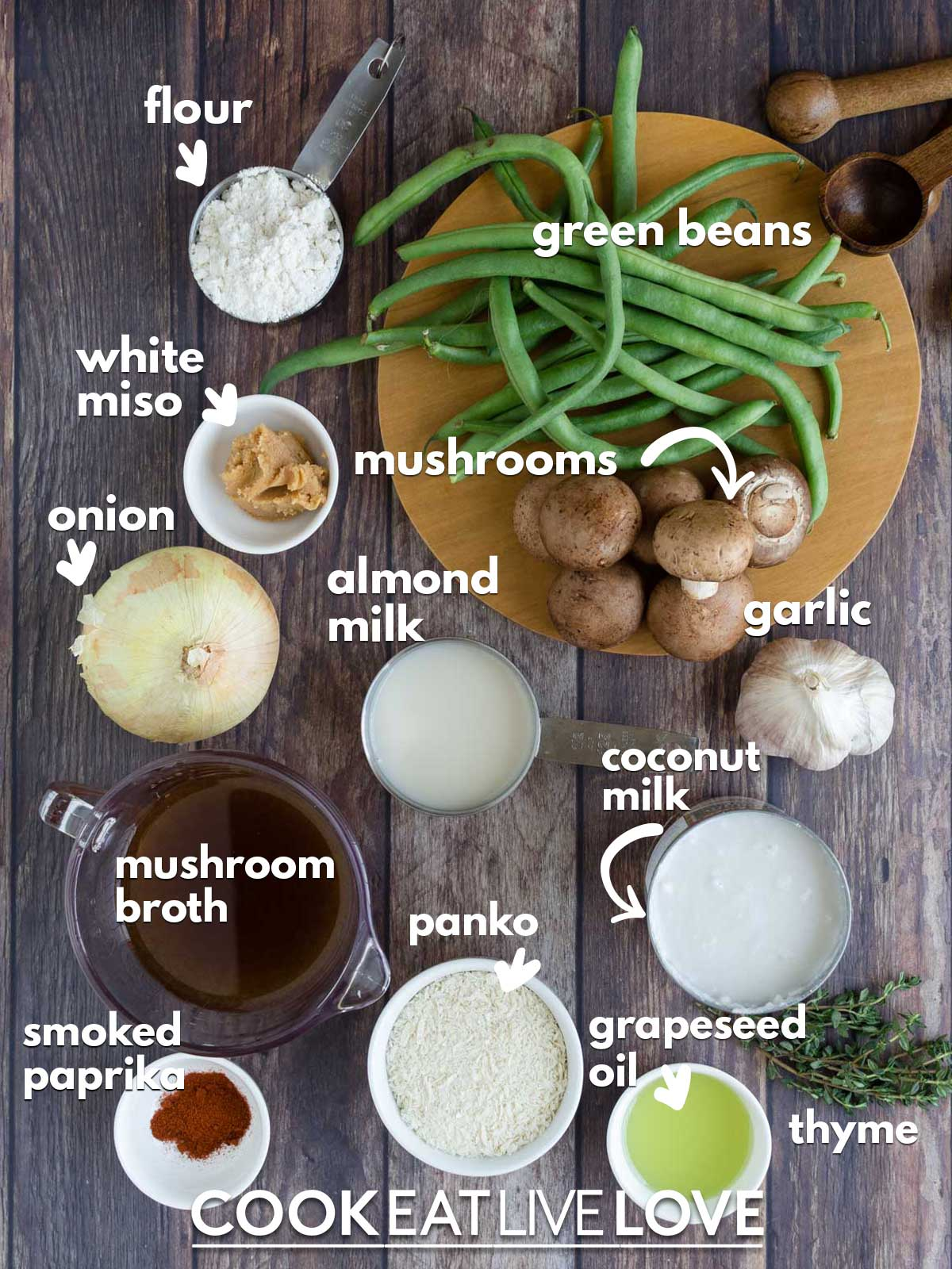Ingredients to make vegan green bean casserole on the counter with text labels