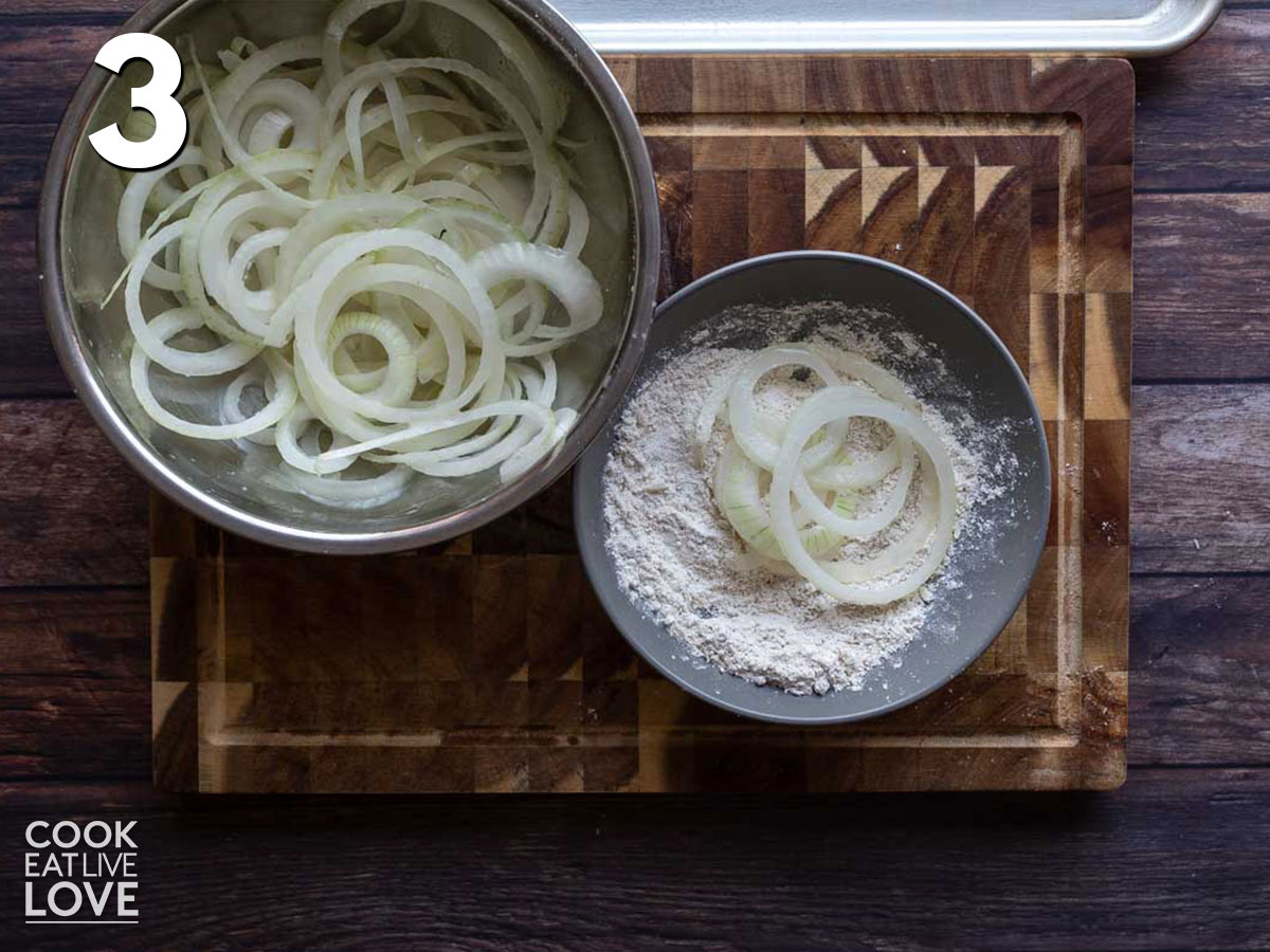 Dipping the onions in the flour mixture