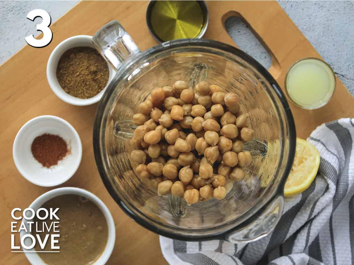 Ingredients to make veggie hummus in the blender