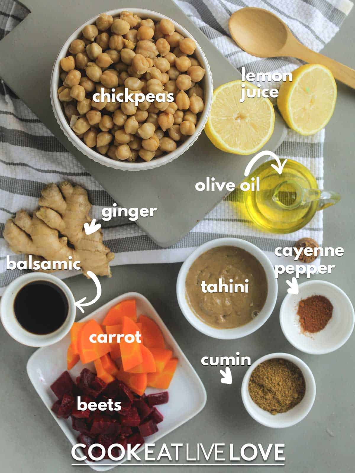 Ingredients to make veggie hummus on the table with text labels