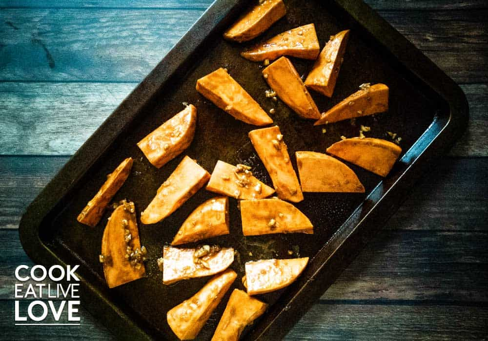 Basalmic miso sweet potatoes on a pan fresh from the oven.