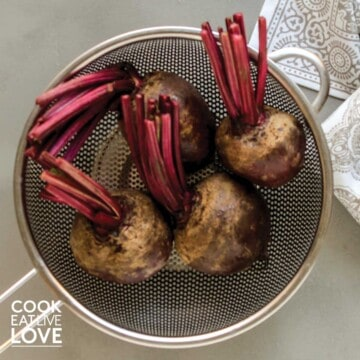 Beets in metal strainer to be cleaned