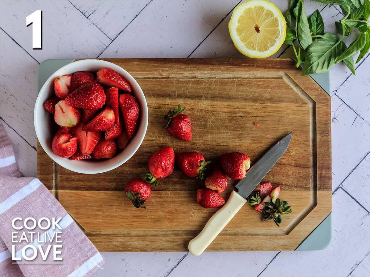 Cutting strawberries on a cutting board