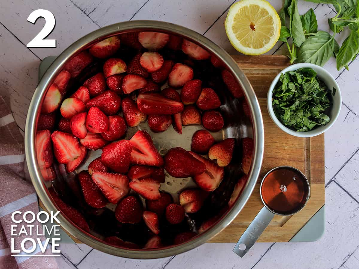 All the ingredients are in the intstant pot to make strawberry basil jam