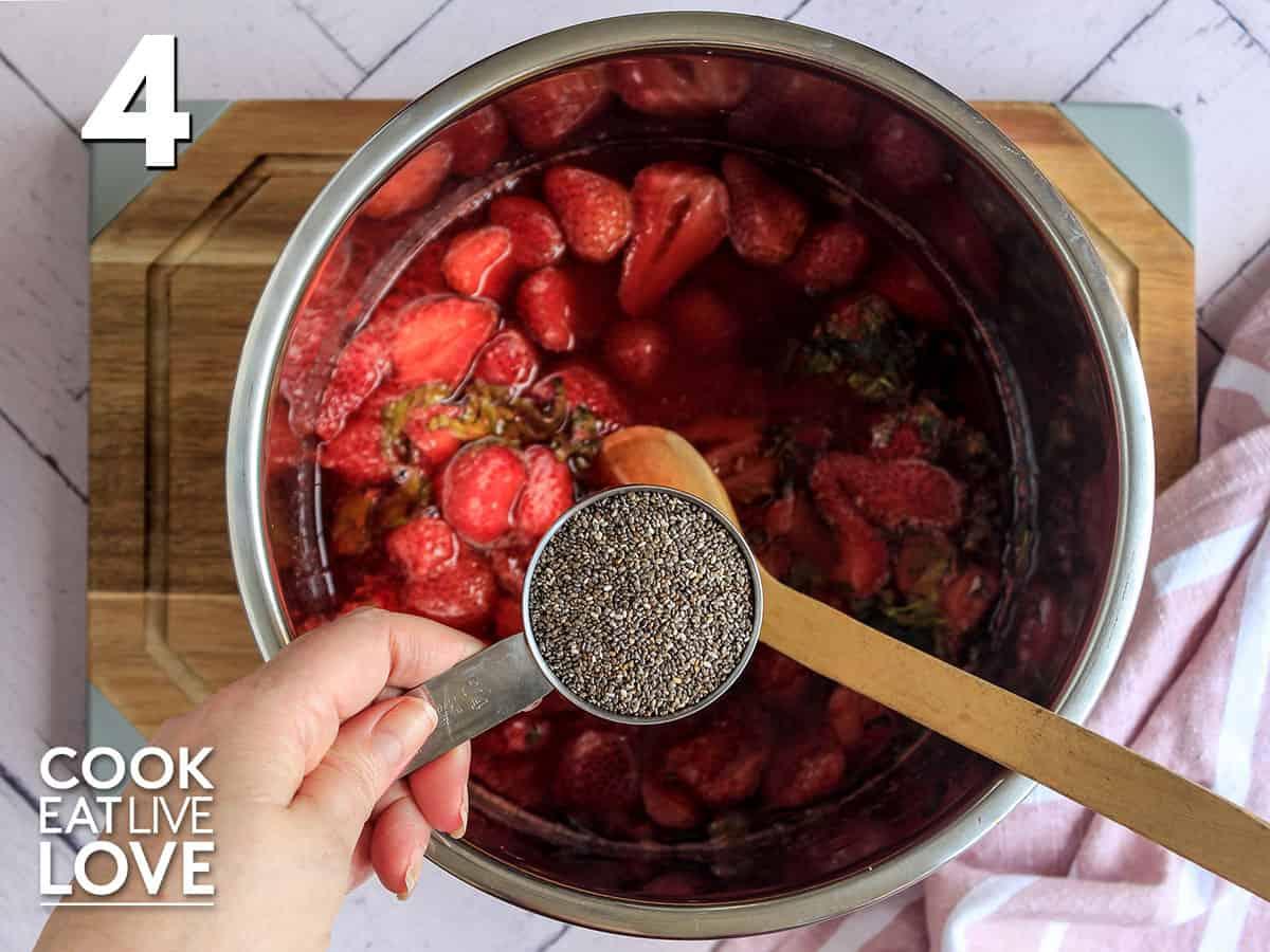 adding the chia to the chia strawberry jam