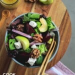Roasted beetroot salad in a bowl with wooden fork