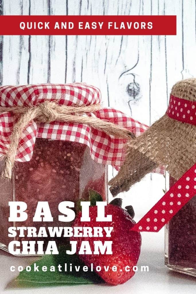 Basil strawberry chia jam in jars with red and white checkered or burlap covered lids with ribbon.