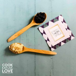 Coconut oil hand scrubs shown on wooden spoons