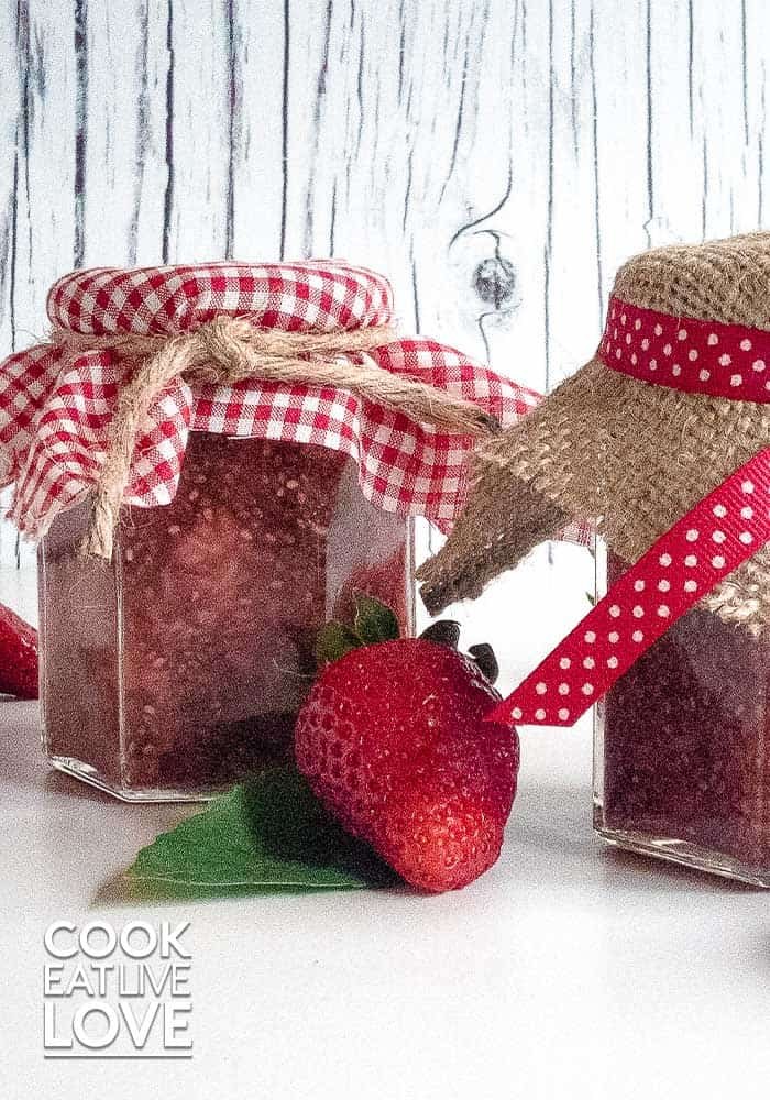 Strawberry jam in jars with red checkered lids and burlap string are great easy food gifts.
