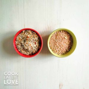Herb salt blends are ready for cooking in small bowls on light wood background.