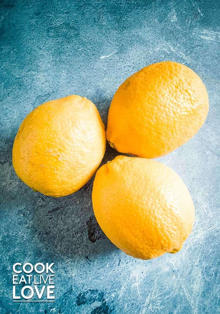 Whole lemons on a blue table