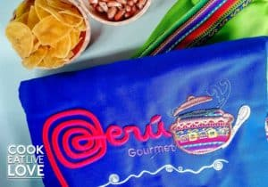 Close up of Peru apron and snacks given during vegetarian cooking class in Peru.
