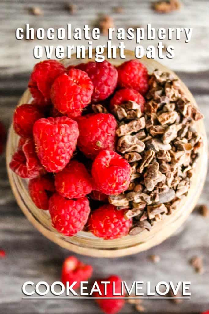 Pin for chocolate overnight oats with closeup photo of top raspberries and cacao nibs.