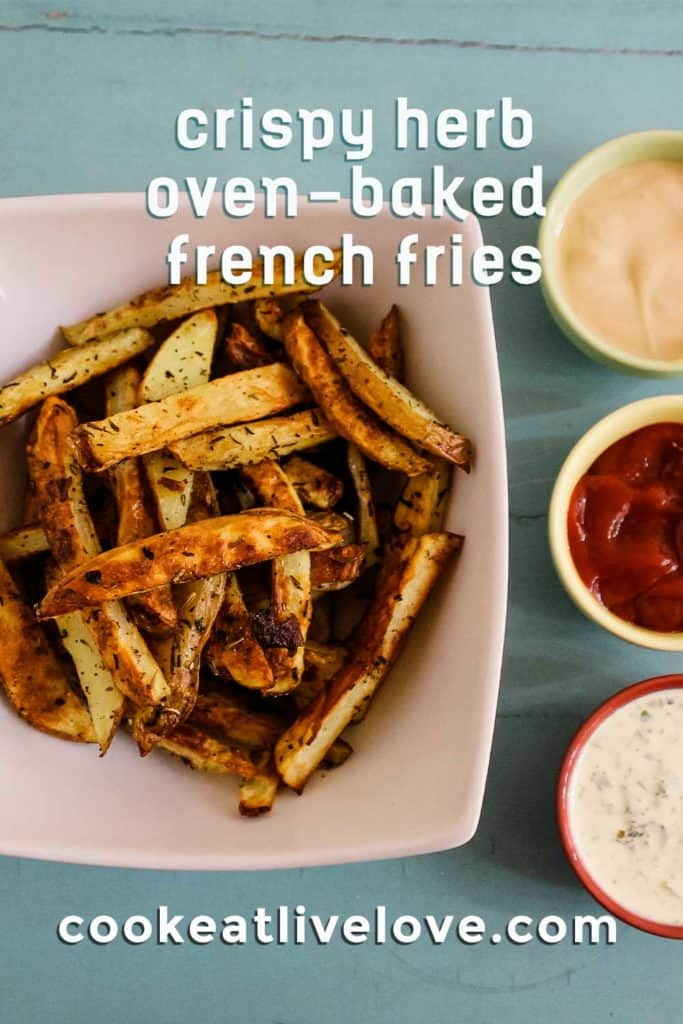 Oven baked fries pin pinterest with bowl of fries and three sauces.