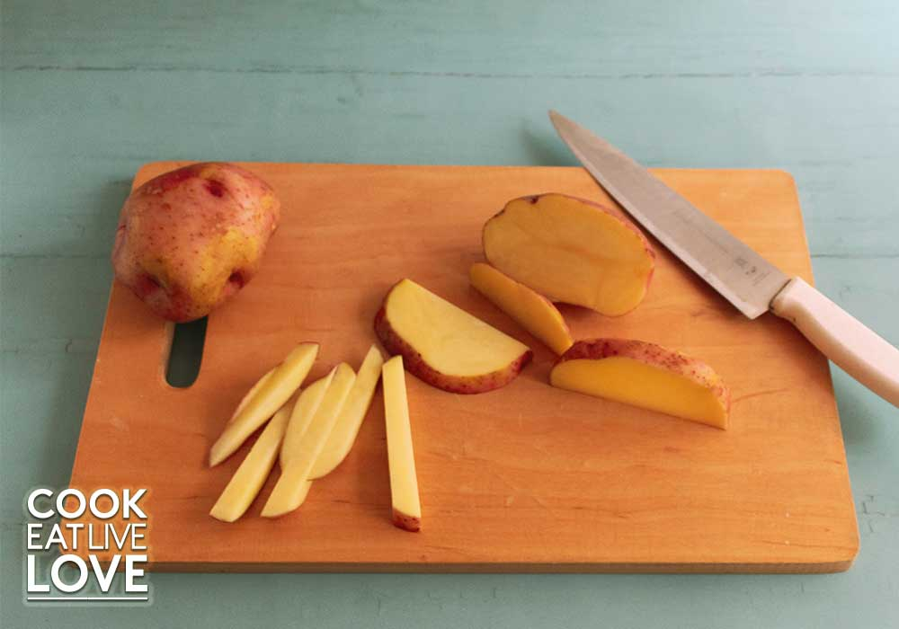 Potatoes for oven baked fries are then cut into quarter inch slices and strips.