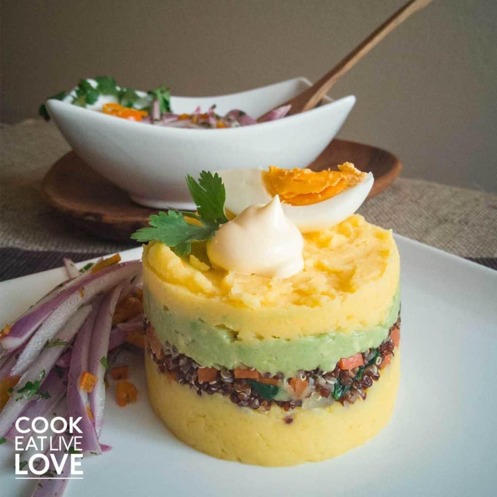 Plate with layered peruvian potato dish