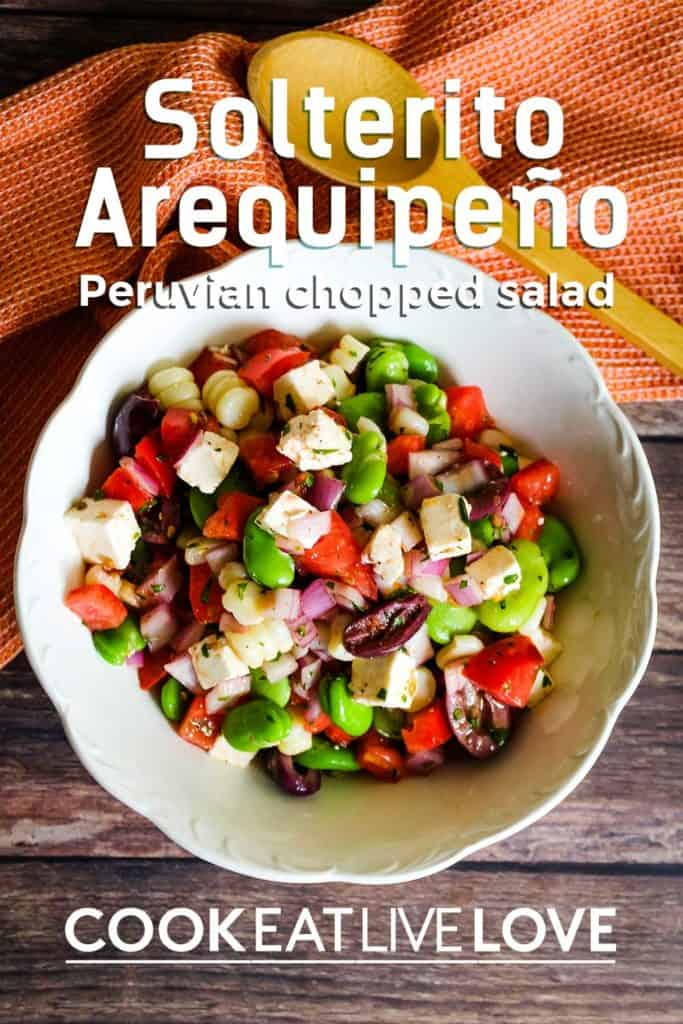 Pin of solterito arepequiño, a peruvian chopped salad recipe in white bowl on dark wood background.