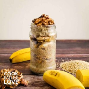 Quinoa breakfast bowl in jar surrounded by ingredients, quinoa, banana, walnuts.