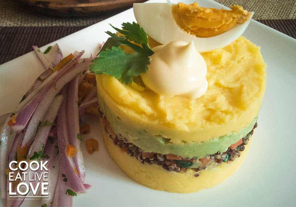 Closeup of vegetarian causa with potatoes, avocado and quinoa.