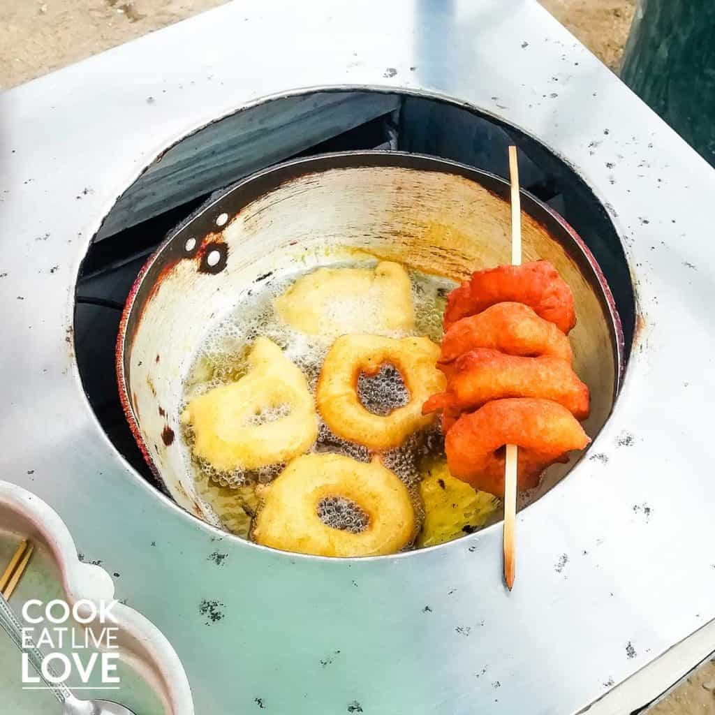 Food in lima Peru inlcudes picarones cooking in oil