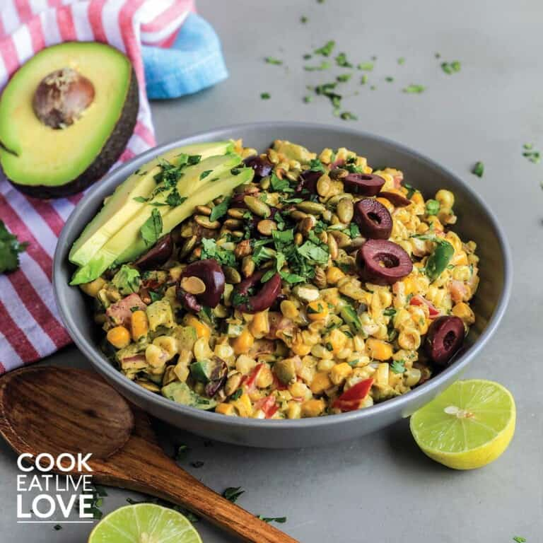 Square bowl of corn salad on a table
