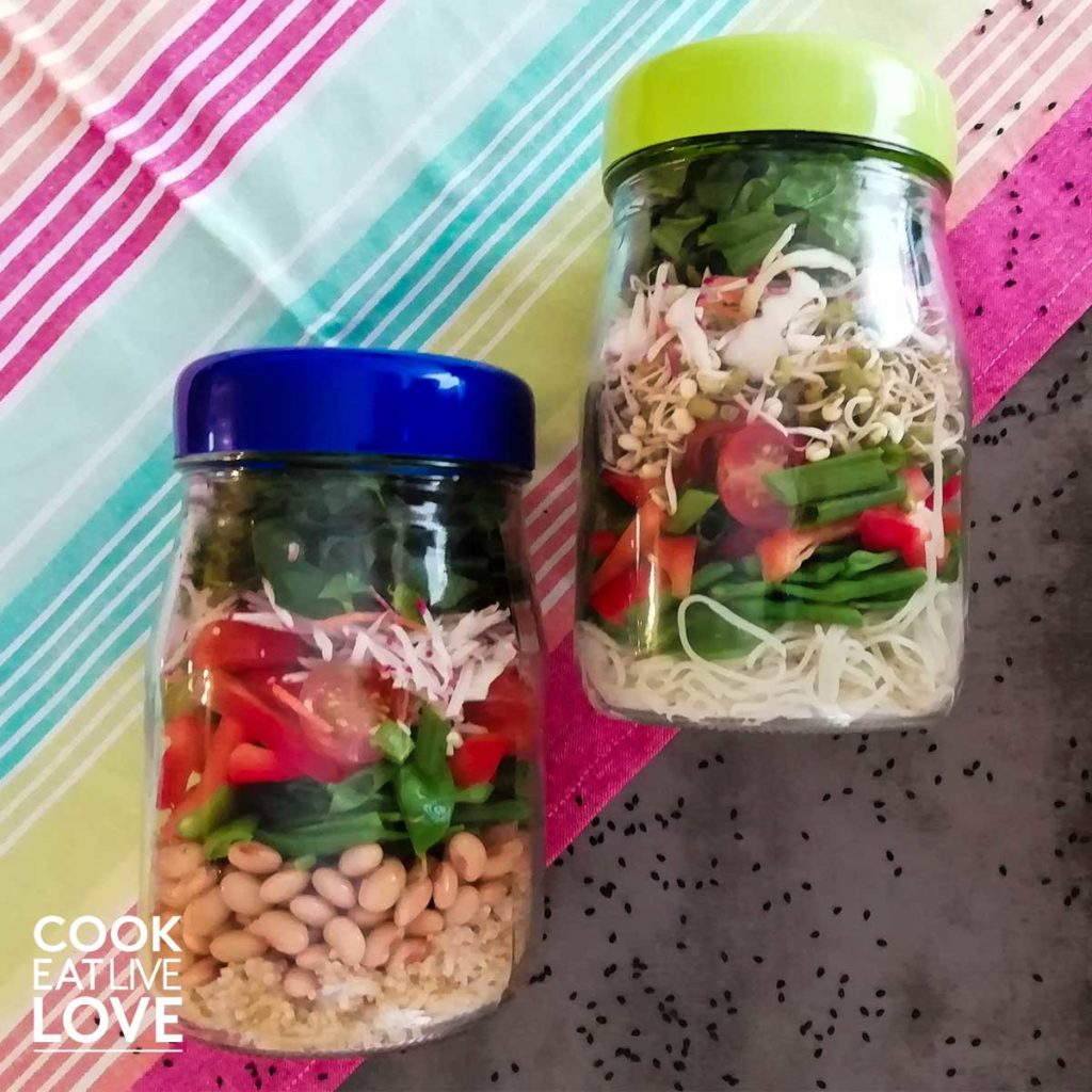 Salad in jars on table