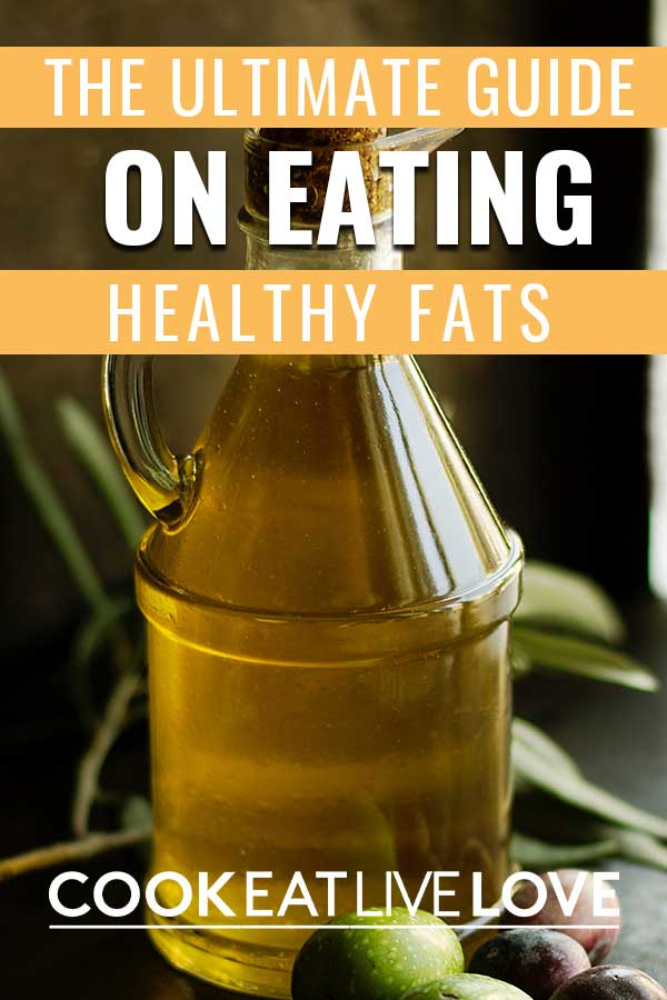 "Pin for pinterest with Text ""The ultimate guide on eating healthy fats"" on top of a photo of olive oil in jar."