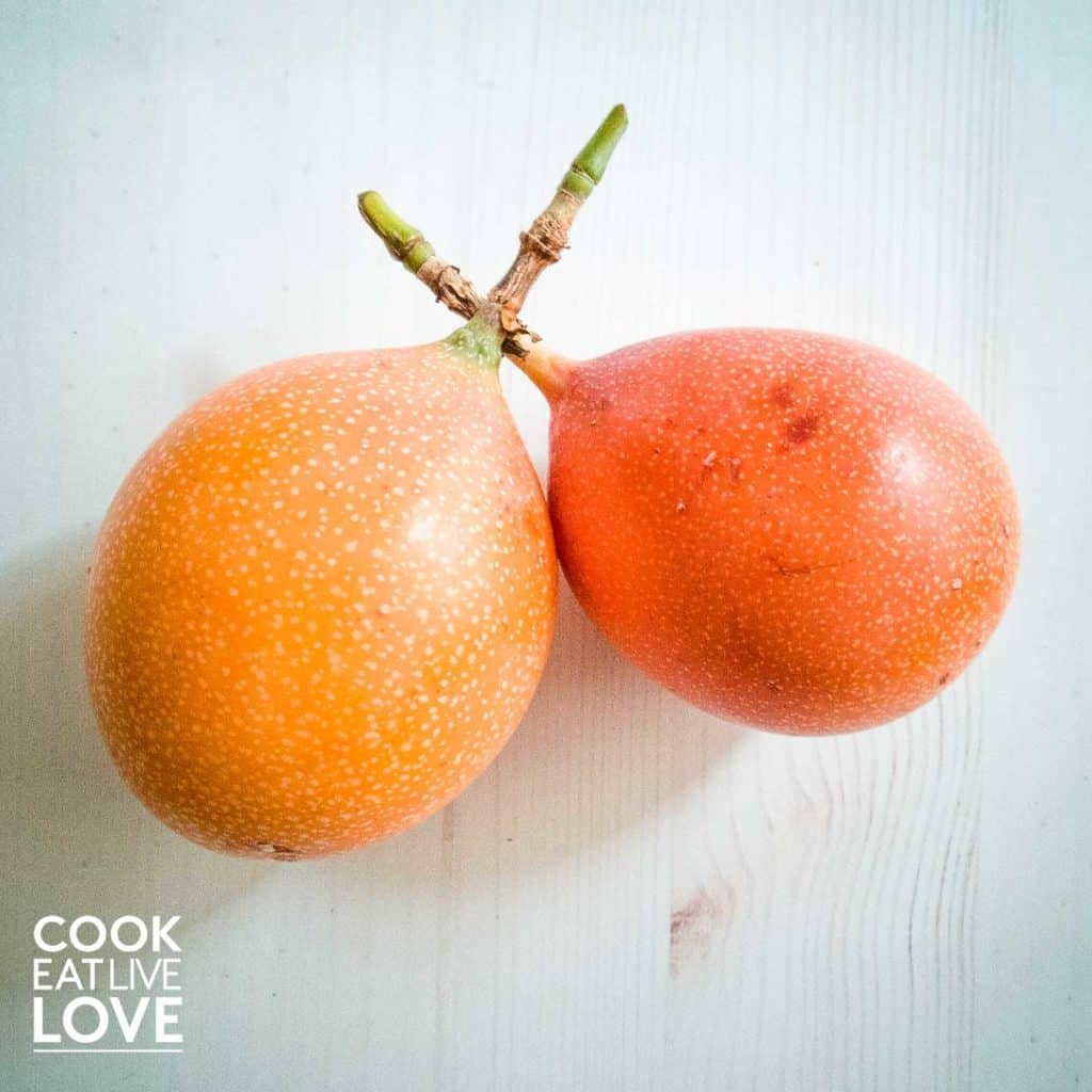 Food in Lima inlcudes grenadilla a light orange fruit with a smooth shell with white speckles.