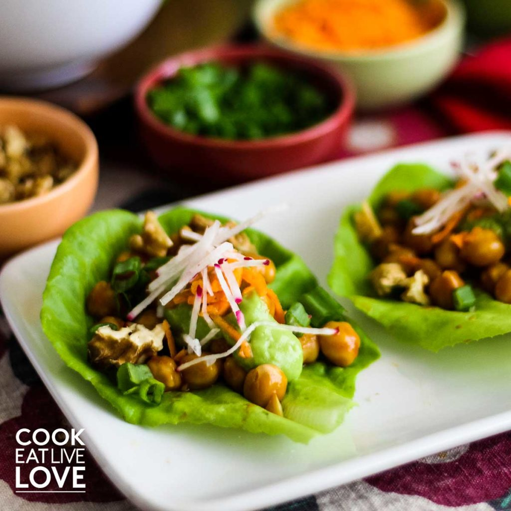 Vegetarian lettuce wraps with buffalo chickpeas are shown prepared and ready to eat.