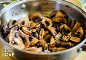Cooked mushrooms to use in mushroom stroganoff are shown cooked just until browned and slightly tender.