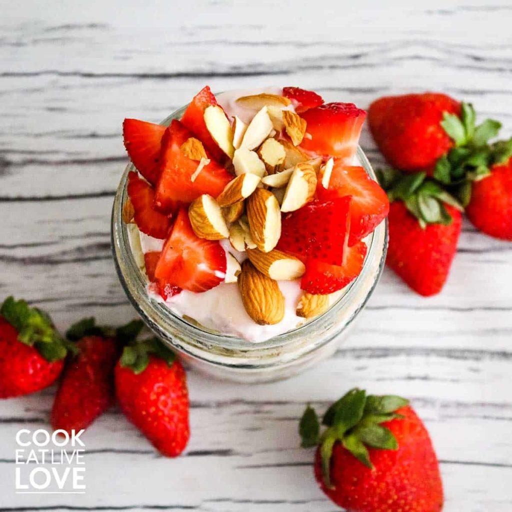 Yogurt parfait in jar with strawberry and almonds on a jar