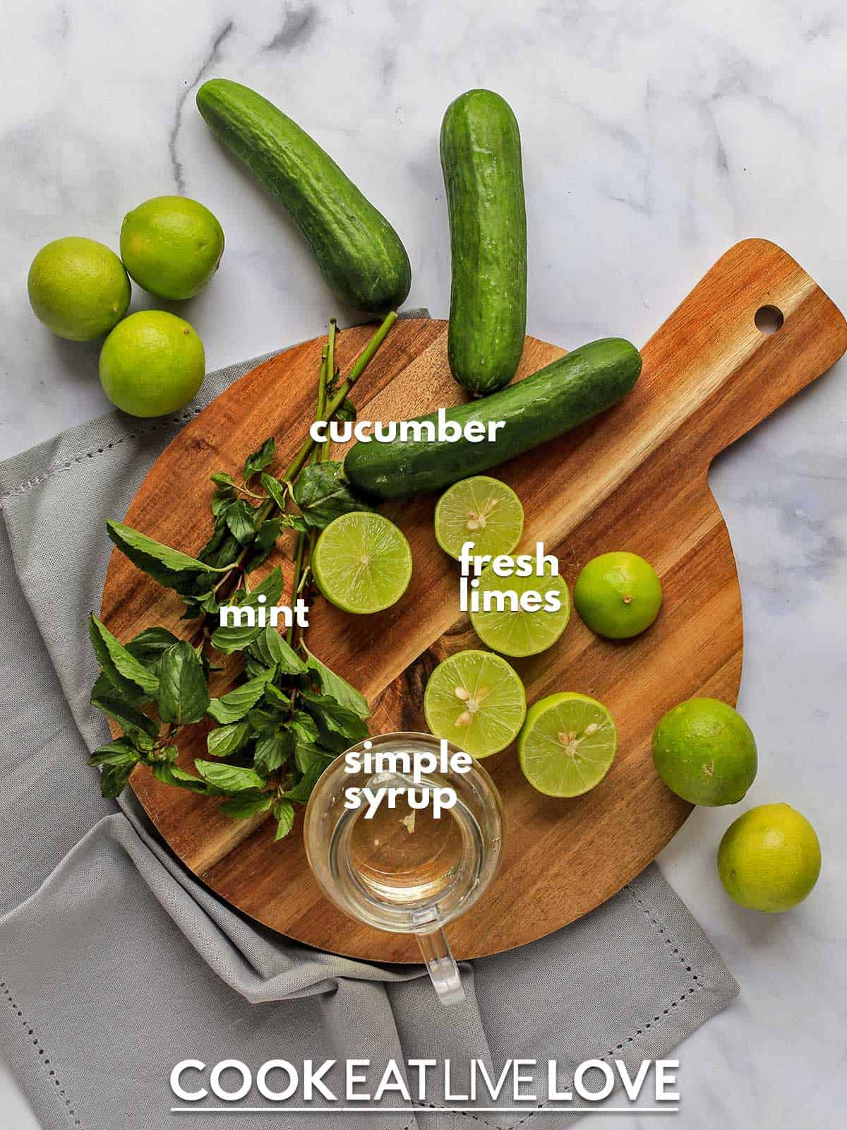 Ingredients to make cucumber spritzer on the table with text labels