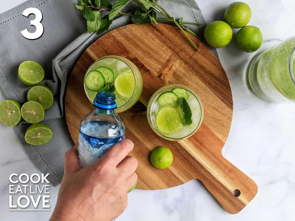 Pouring the seltzer in the cucumber drink