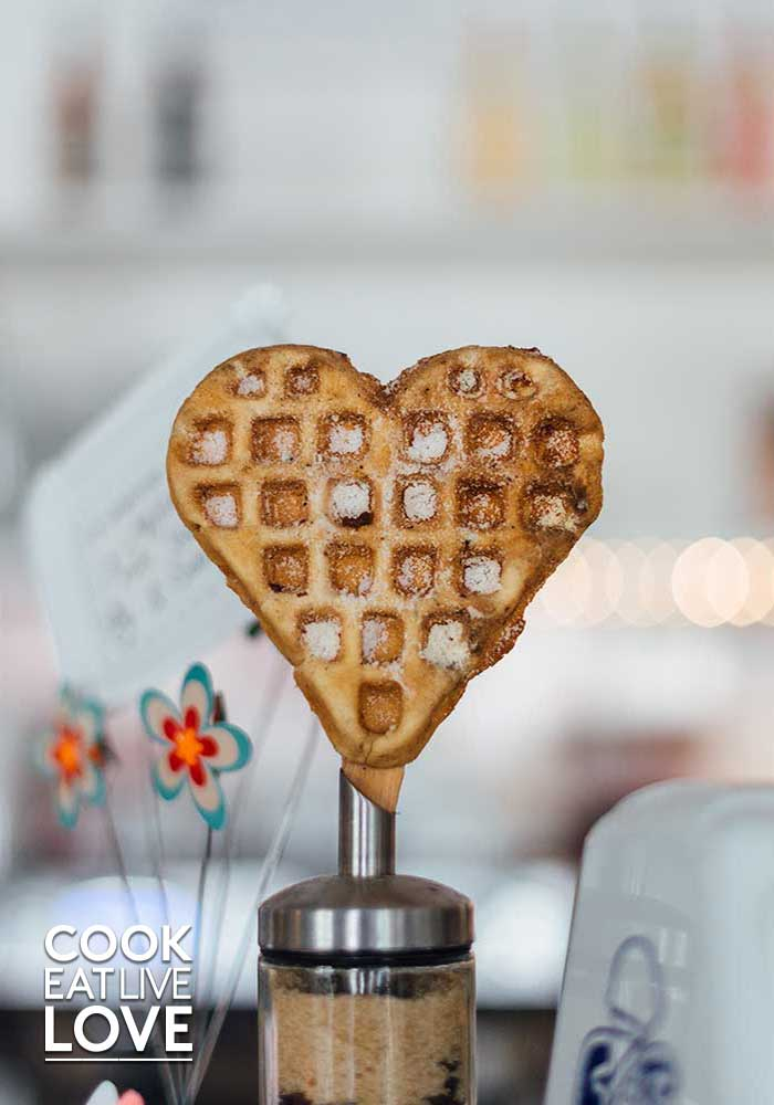 Photo of a heart shaped waffle standing in a base.