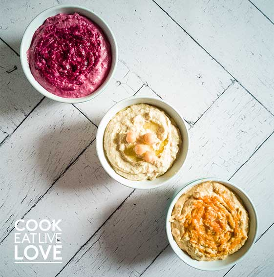 All three easy vegetable hummus flavors in a row.