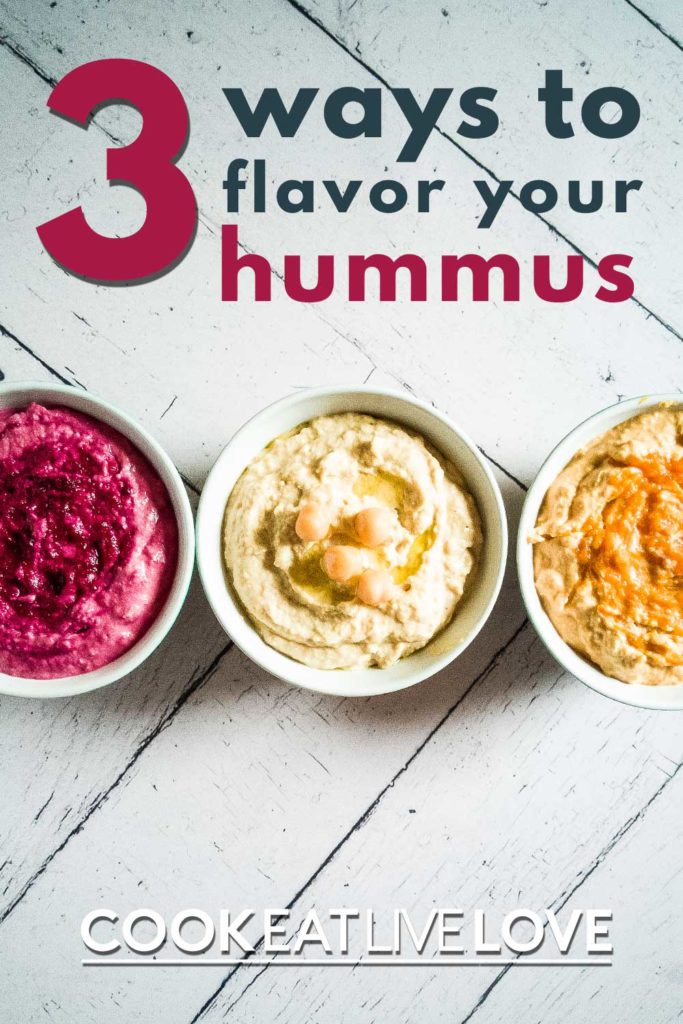 Pin for pinterest of vegetable hummus trio.  Photo of three bowls, one of each flavor with text on top 3 ways to flavor your hummus.