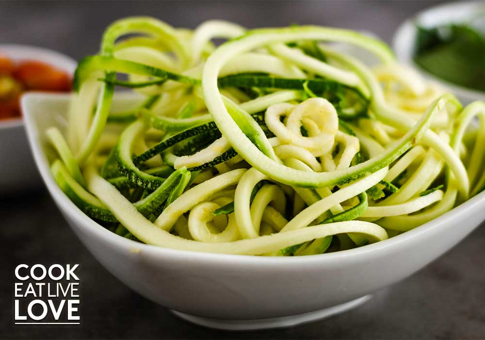 Photo of zucchini noodles which are added to this caprese pasta recipe.