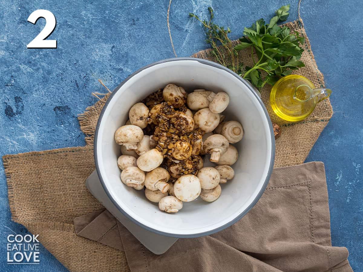 Marinade added to bowl of mushrooms
