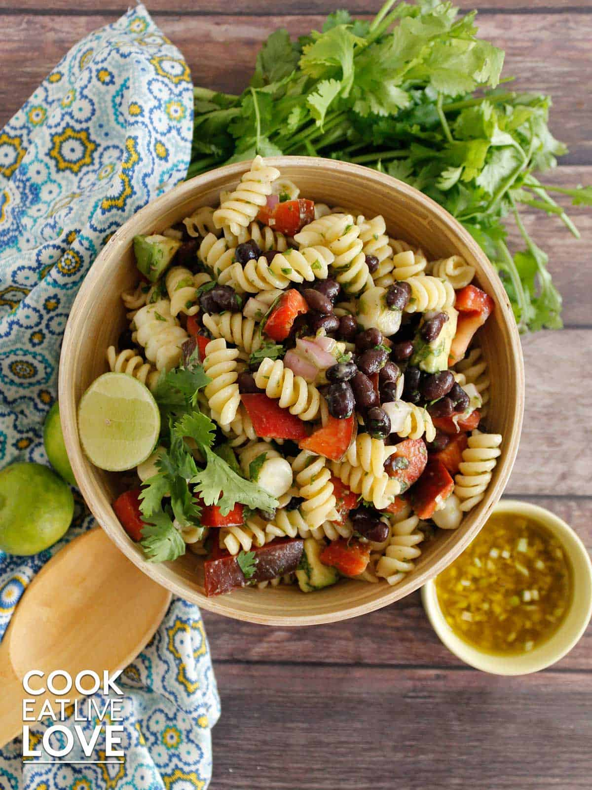 Bowl and plate of pasta salad on a table