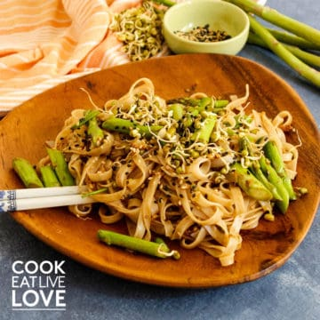 Noodles, sprouts and asparagus on a plate.