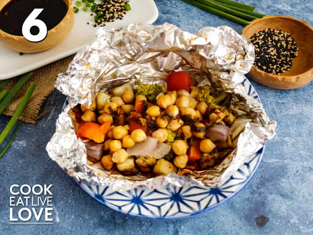 Vegetable teriyaki packet is finished and open showing cooked vegetables and chickpeas ready to serve.