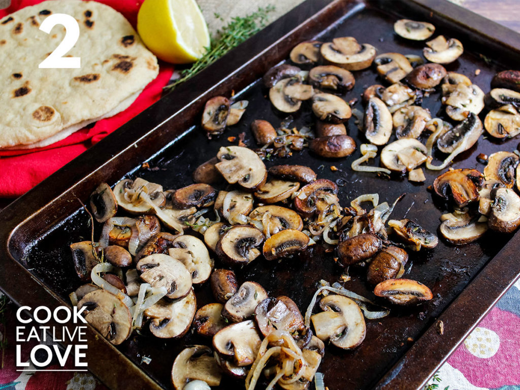 Baking tray of cooked mushrooms lightly golden brown to use on the vegan flatbread sandwich.