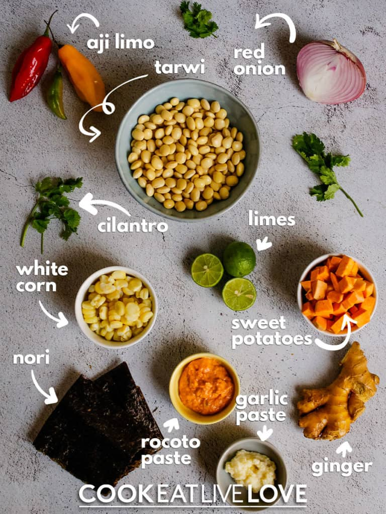 Ingredients for making spicy ceviche photoed from above.  Aji limo, tarwi, red onion, limes, sweet potatoes, , ginger, garlic paste, rocoto paste, seaweed, white corn and cilantro.
