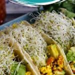 Pin for pinterest with photo of three tacos on a plate and text on top.