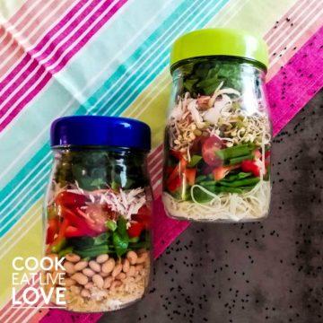 Jars of asian salad on table