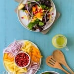 Mango salad on white plate with jar of avocado dressing.