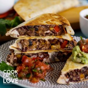 Stack of quesadillas on a plate.