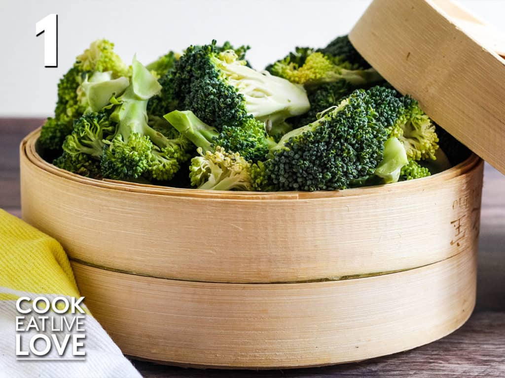 Cut broccoli in steamer basket to show the size to cut broccoli.