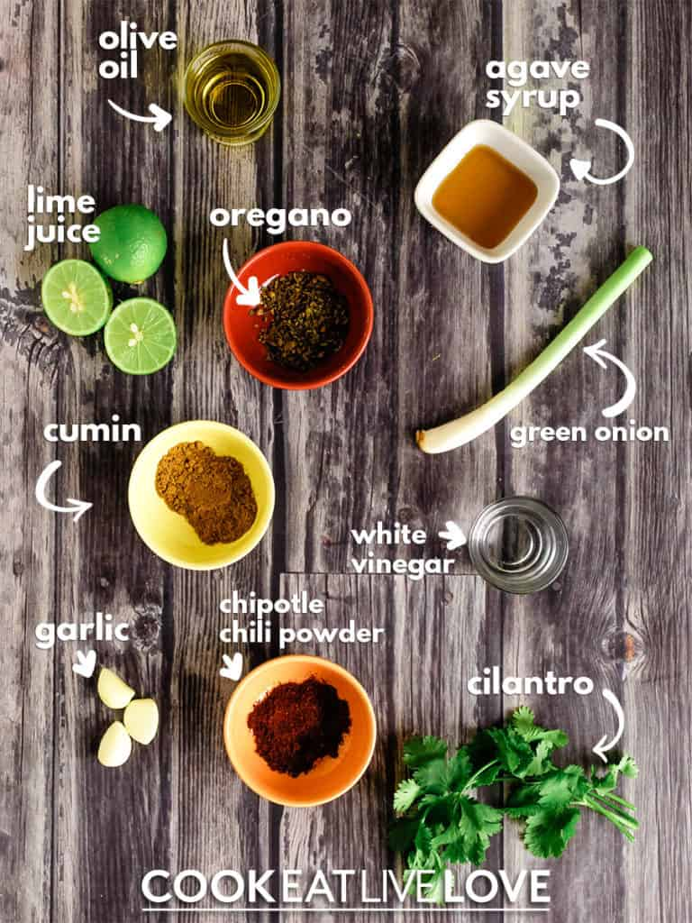 Ingredients to make salad dressing with text labels.